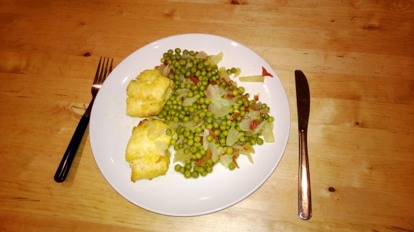 Pike Place Fish Market battered Cod + sweet peas sauted with caramelized onions and serrano ham